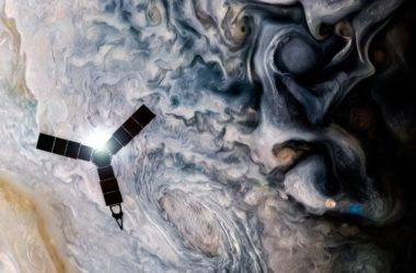 An illustration of NASA's Juno spacecraft flying above the clouds of Jupiter