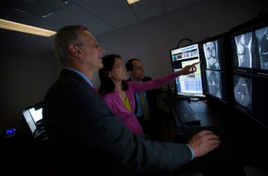 Recht, Sodickson, and Lui examine MRI scans of a knee at NYU Langone Health in August 2018.