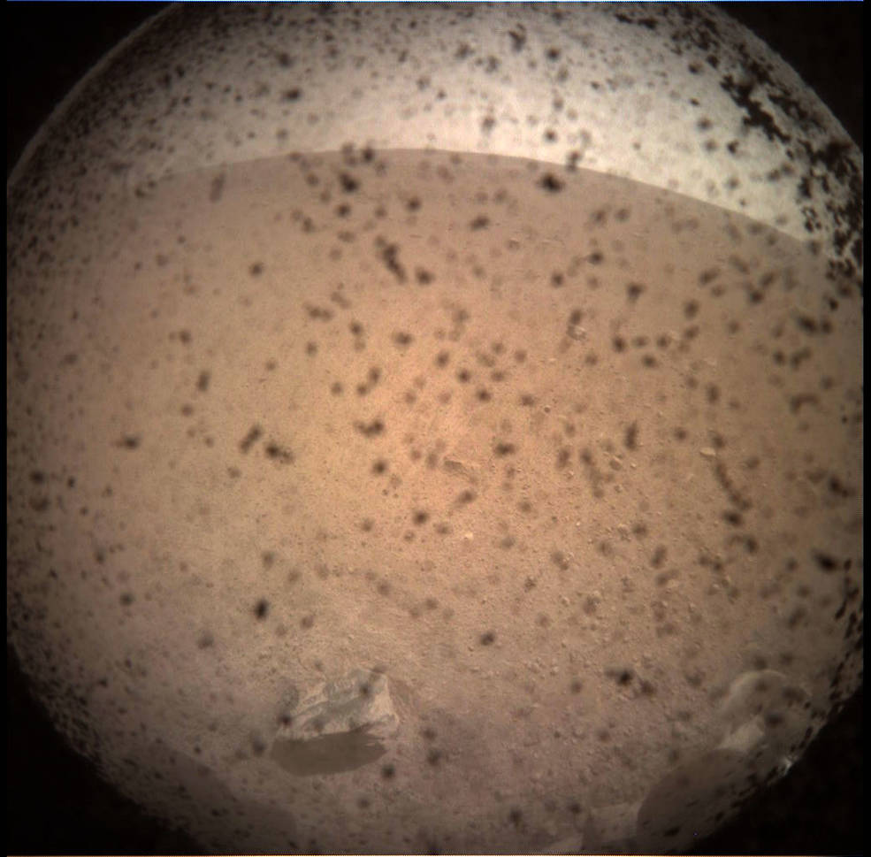 NASA's InSight Mars lander acquired this image of the area in front of the lander using its lander-mounted, Instrument Context Camera (ICC). This image was acquired on Nov. 26, 2018, Sol 0 of the InSight mission where the local mean solar time for the image exposures was 13:34:21. Each ICC image has a field of view of 124 x 124 degrees. Credits: NASA/JPL-CalTech
